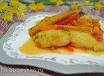 Тажин с белой рыбой под красным соусом, с солеными лимонами