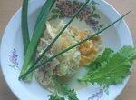 Филе минтая на подушке из кабачков под луком и сыром
