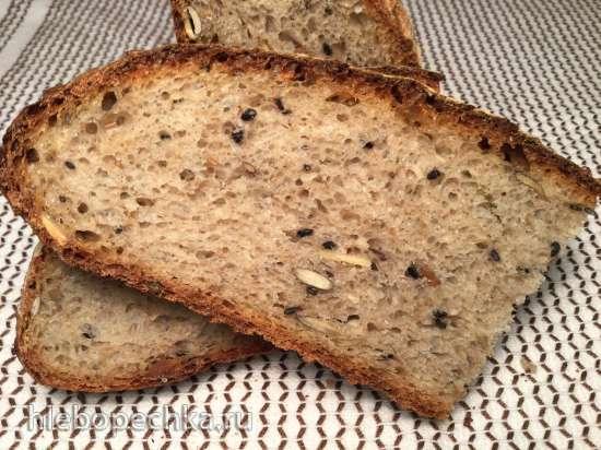 Пшеничный каравай из печки на закваске с семенами, цельнозерновой и полбяной мукой
