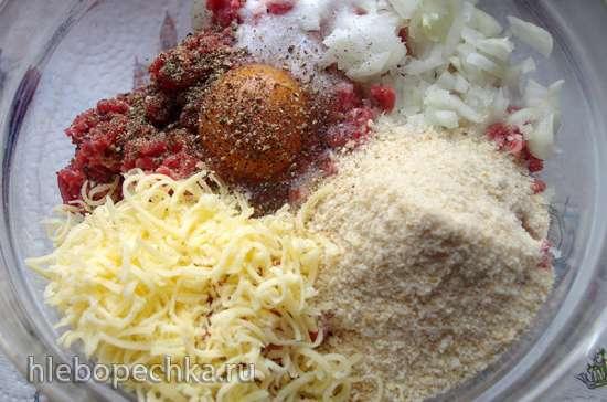 Тефтели, запеченные под сливочно-грибным соусом