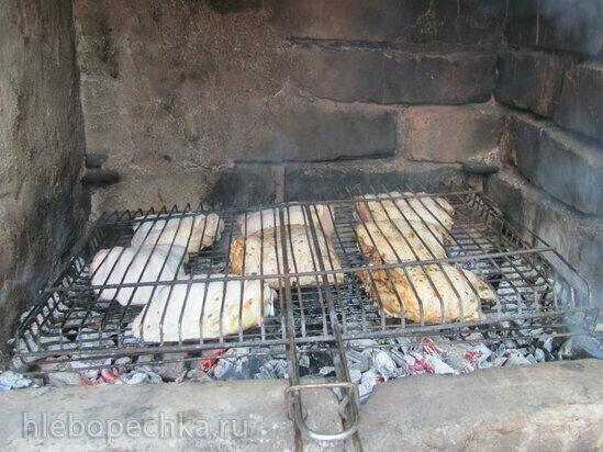 Куриные бедра на углях